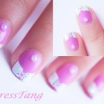 pink_and_white_corset_nail_art_2_by_empresstang-d4ii3f2